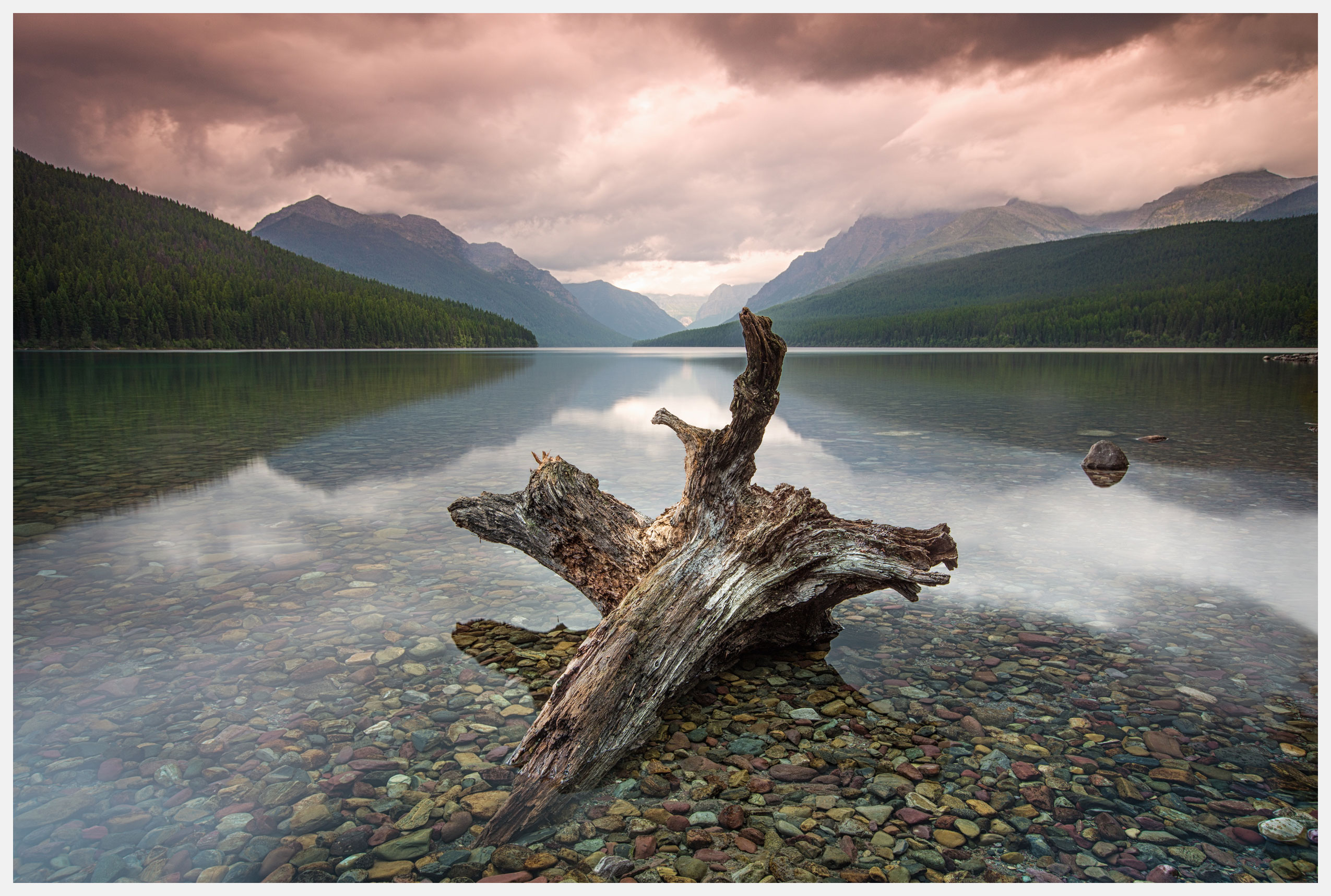 Clear-lake-with-dramatic-sky-glacier-national-park-montana