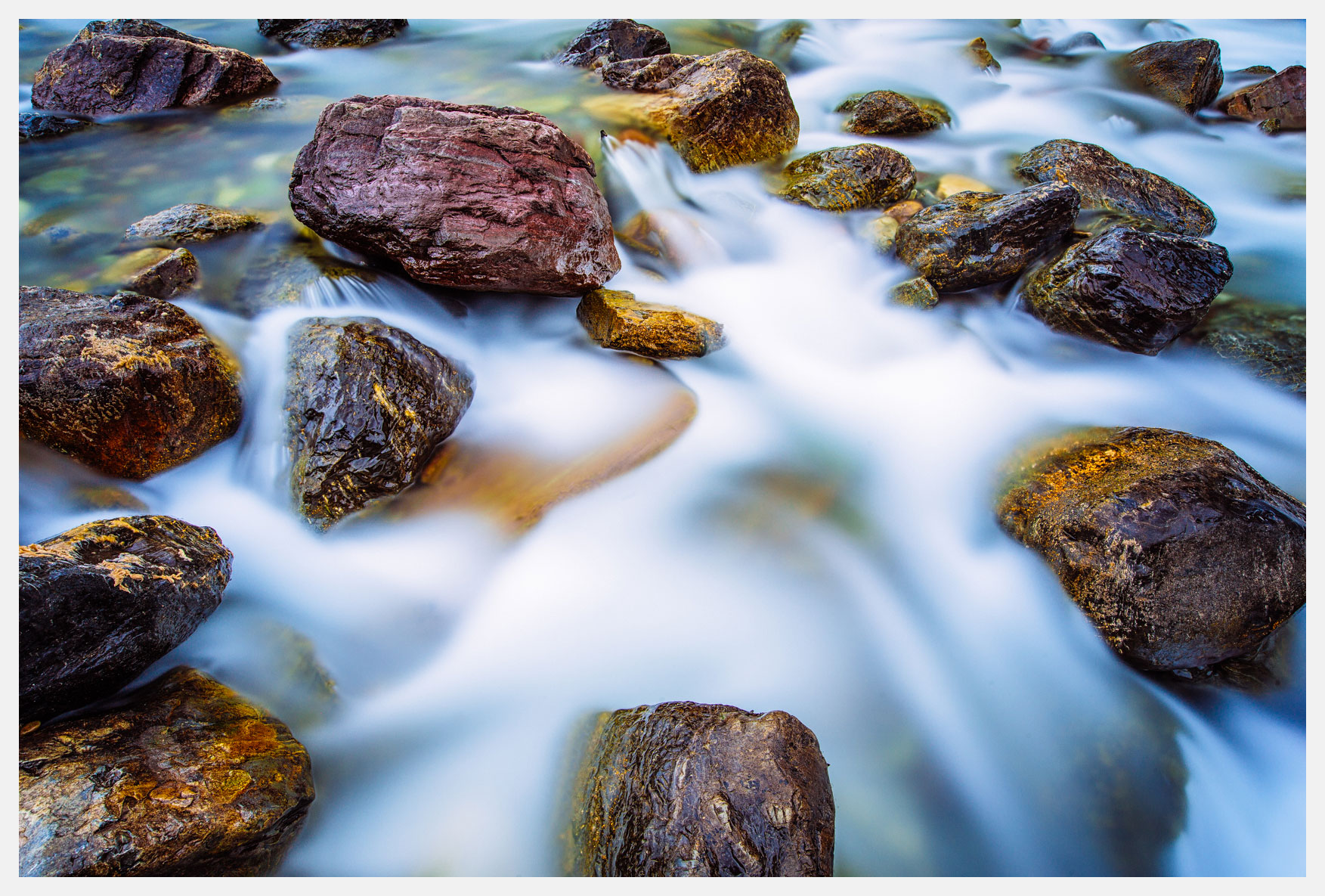 Water-Flowing-Over-Boulders-Glacier-National-Park-Montana
